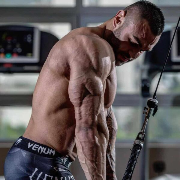 Hristijan Manasievski doing a triceps exercise at the gym in order to improve on his muscle growth