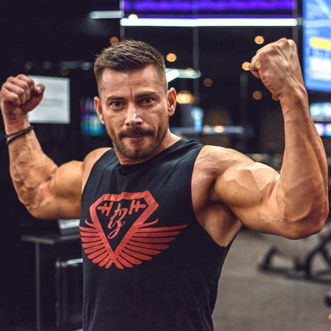 Trajche Stojanov flexing his hand's muscles and starting at the camera