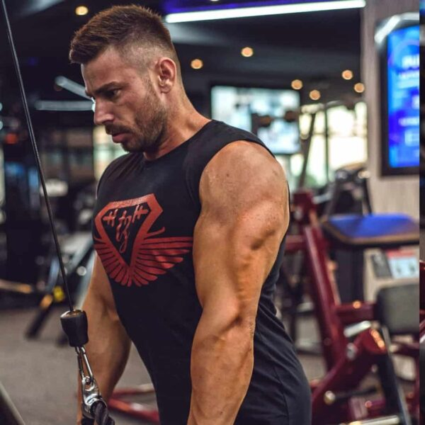 Trajche Stojanov training his triceps muscles at the gym